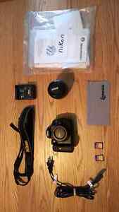 Nikon D5000 with kit lens 18-55mm and accessories