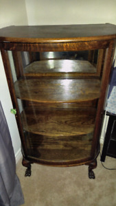 Antique display cabinet with rounded glass door