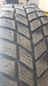 Snow tires with steel rims for sale