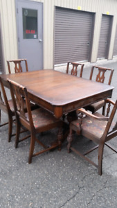 1920's solid walnut dining room table with 6 chairs