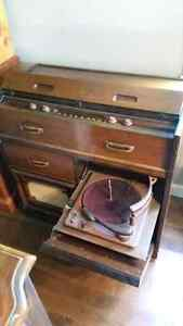 Antique record player and radio cabinet