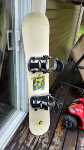 Ladies small snowboard, bindings and size 7 boots