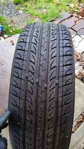 NEXT TO NEW ONLY HAVE 1- 215 65 16 ALL SEASON TIRE