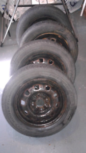 Four tires with rims 185/65  R 14