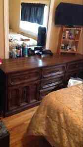 Selling a wooden dresser with a mirror for $100 obo
