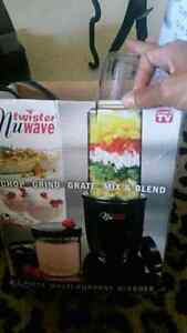This blender mixer and grinder in one is like new in box!!