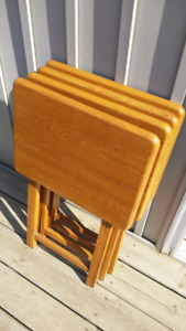 4 solid wood tv tray tables. Good condition.
