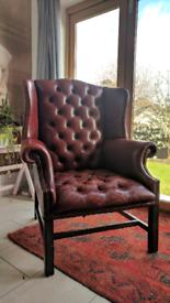 Large vintage studded red leather wingback armchair chair