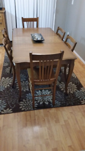 Nice solid wood kitchen table with 6 chairs.