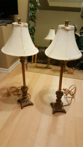 Set of two matching antique brass lamps