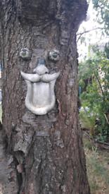 Funny face tree bird feeder