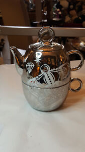 Silver Teapot and Cup