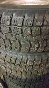 Studded Winter Tires 215/70R14 on 5 bolt Ford rims Prince George British Columbia image 2