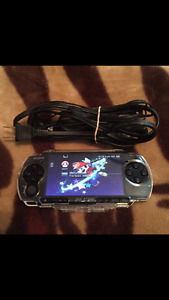 PSP SLIM WITH 10000 GAMES