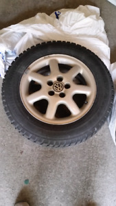 4 Used Winter Tires with Rims