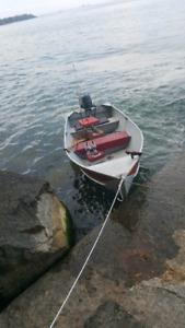 13' boat with 18hp motor and trailer