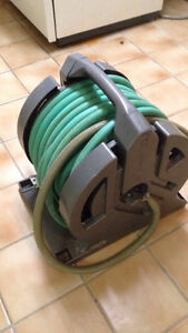 Hose with wall/floor holder
