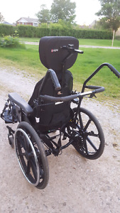 Tilt and space wheelchair