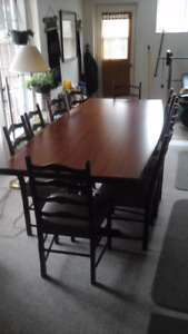 Nice 8 foot table with 14 chairs
