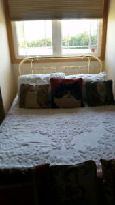 Brass double bed with mattress and boxspring