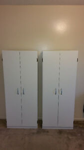 2 white cabinets with 4 shelfs
