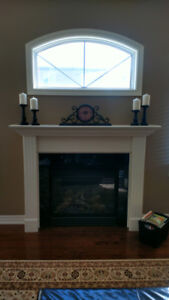 Gas fireplace mantel with marble surrond