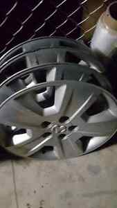 "4 x 17"" dodge caliber factory hubcaps $50 o.b.o"