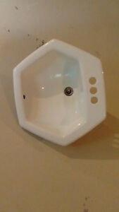 2 white cast iron sinks
