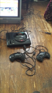 SEGA GENESIS game console with 2 controllers and 14 games