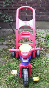 Tricycle with handle.