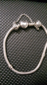 Pandora bracelet with safety chain