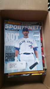 Box of Sportsnet magazines.