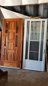 solid wood front door with aluminum screen door