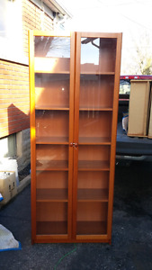2 Ikea Maple Cabinets with Glass doors and 1 book case .