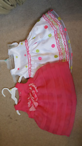 2 dresses size 3 to 6 months with tags