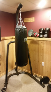 70 pound punching bag with stand and 16 oz gloves