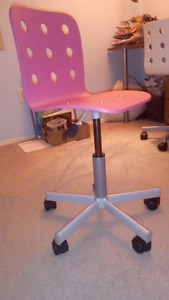 Pink office chair adjustable and on wheels