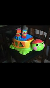 Fisher Price Peek A Boo Build and Spill Musical Turtle.