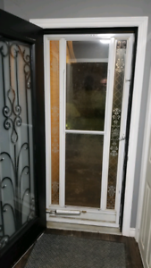 White storm door with frame