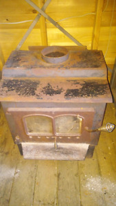 SHOP WOOD STOVE WITH PIPES