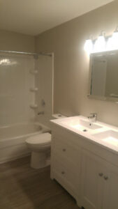 3 bedroom with fenced yard and parking, heat and water includ.
