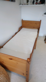 Ikea saltan lade pine adjustable bed with mattress.