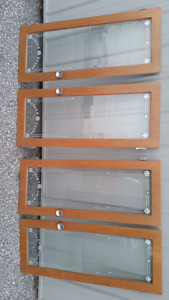 Beautiful glass cabinet doors and bottom wood doors.
