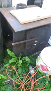Wood stove and 4 pieces of selkirk for sale or trade.