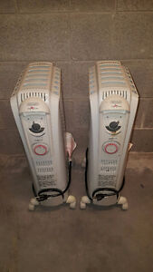 DeLonghi Electric Oil Filled Radiator Model TRD0715T with Timer West Island Greater Montréal image 1