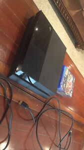 PlayStation 4 w/ cables and 4 games - GREAT condition