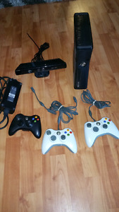 Xbox 360 with kinect and 3 controllers  and lots of games
