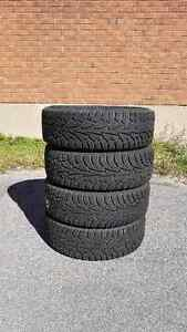 Winter tires on 4 bolt rims 195/65 R14 in good condition