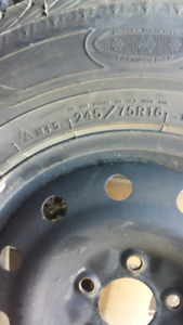 4 Goodyear Ultra-grip snow tires with steel rims.