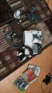 XBOX 360 w/ 2 controllers, headset and 3 games.